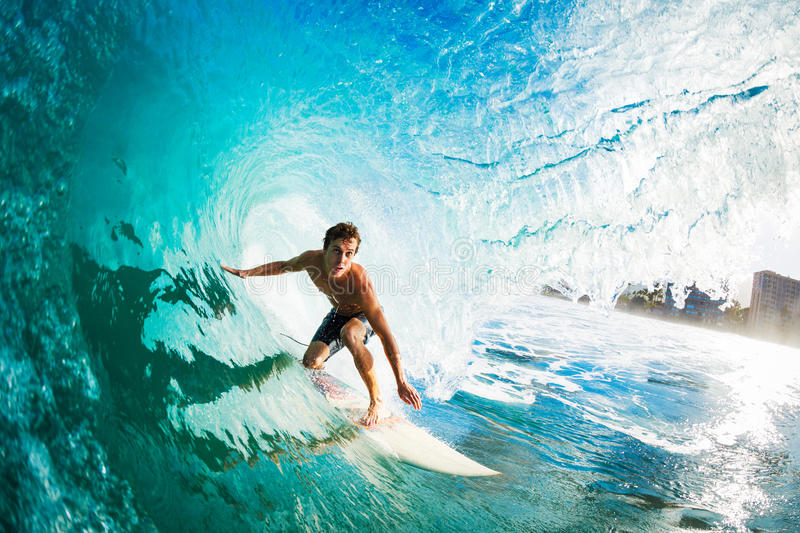 Surfer Gettting Barreled. Surfer on Blue Ocean Wave in the Tube Getting Barreled royalty free stock photo