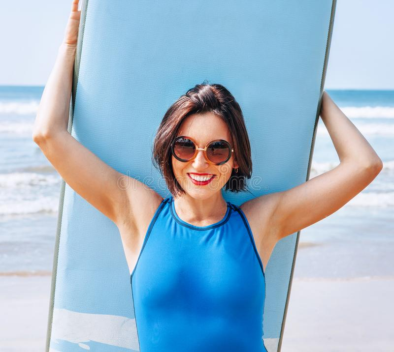 Surfer Girl With Board At Beach Stock Photo