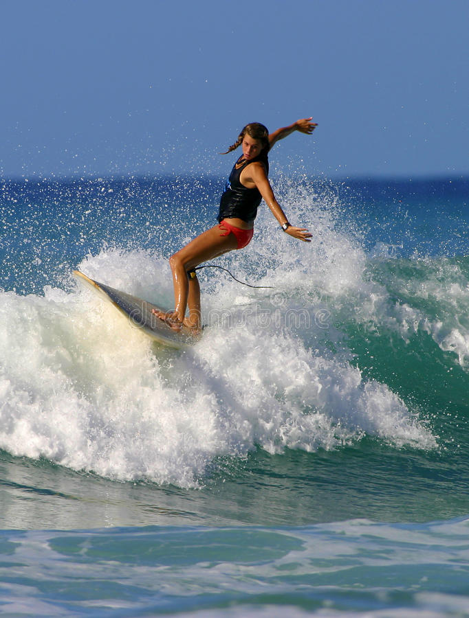 Surfer Girl Brooke Rudow Surfing in Waikiki Beach stock photos