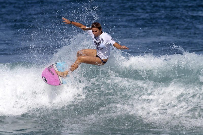 Surfer Girl Coco Ho Surfing in Haleiwa Hawaii royalty free stock photo