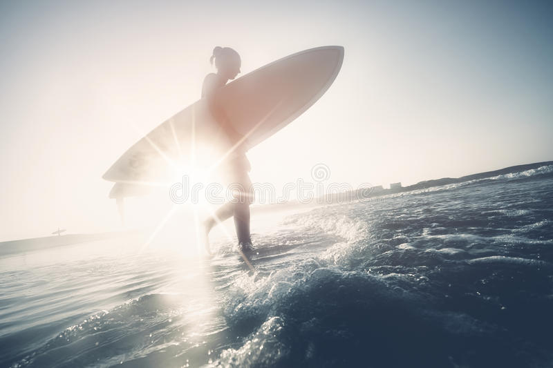 Surfer girl silhouette royalty free stock photo