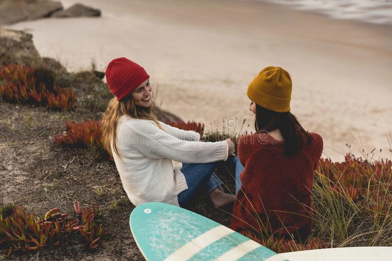 Surfer girls at the beach royalty free stock photography