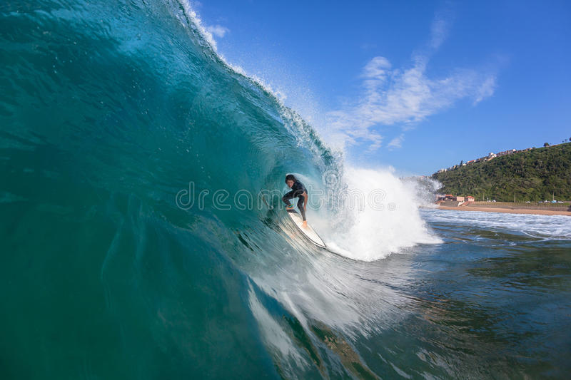Surfer Hollow Wave Water Photo. Surfer surfing inside hollow wave tube ride closeup up water action photo sequence royalty free stock image
