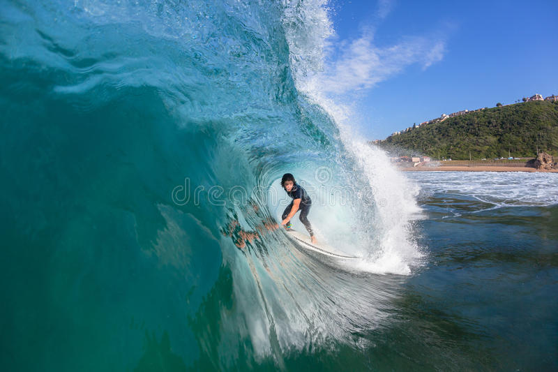 Surfer Inside Hollow Wave. Surfer surfing inside hollow wave tube ride closeup up water action photo sequence royalty free stock images