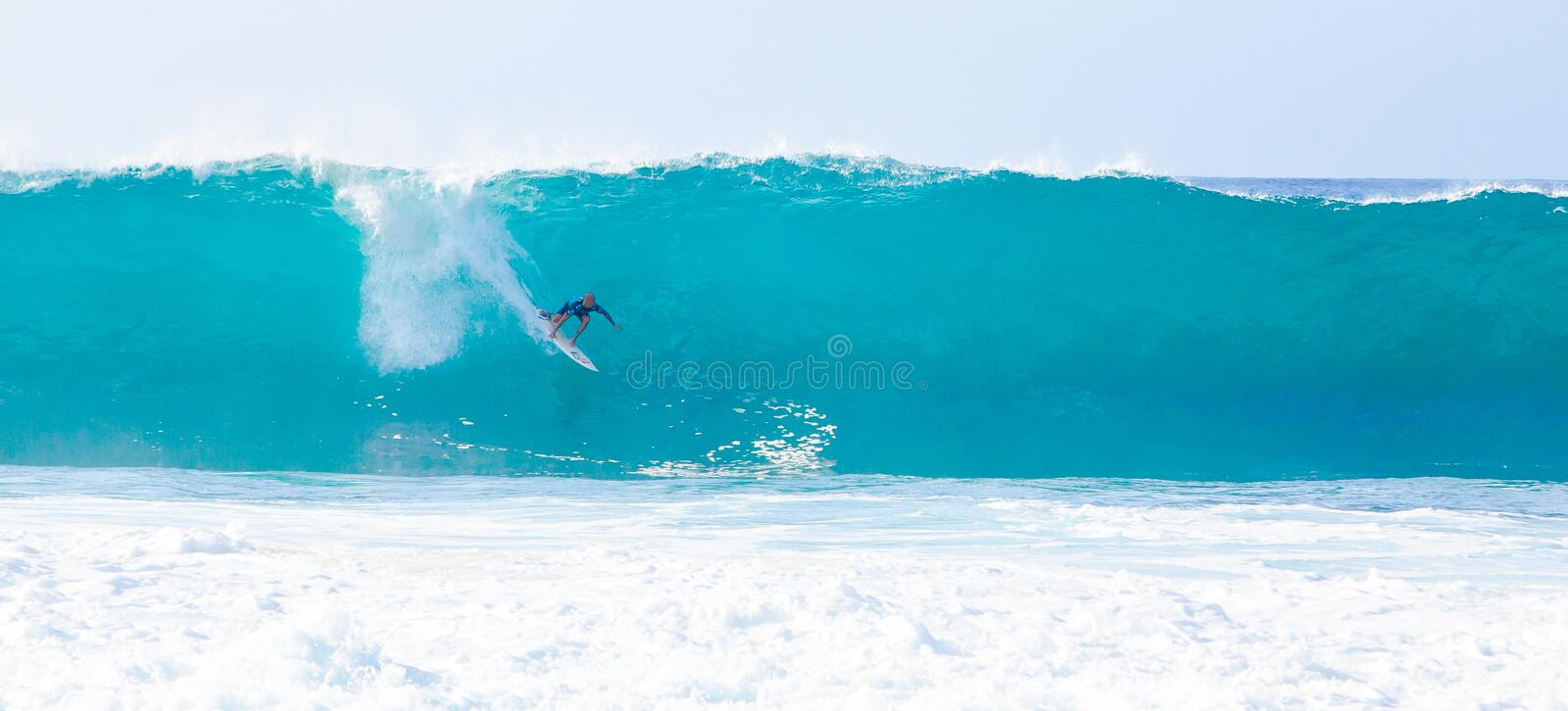 Surfer Kelly Slater Surfing Pipeline in Hawaii stock images