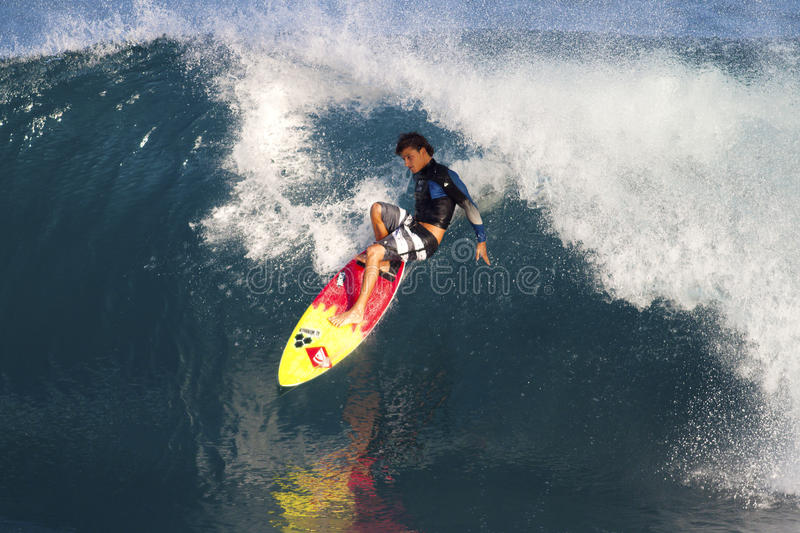 Surfer Kiron Jabour Surfing Off the Wall in Hawaii royalty free stock photos