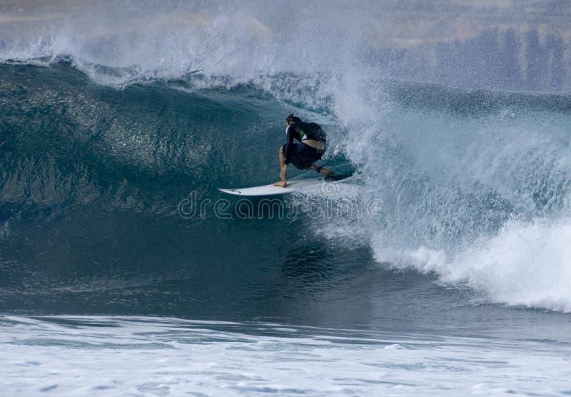Surfer in Las Palmas 2. Surfer carving on a wave in El Confital in Las Palmas in Gran Canaria stock photography