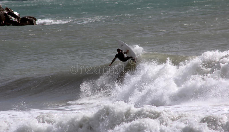 Surfer in Levanto stock afbeeldingen