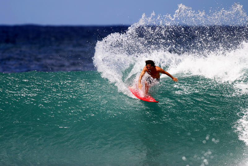 Surfer Mike Latronic Surfing at Rocky Point. Pro surfer, Mike Latronic, surfing at Rocky Point on the North Shore of Oahu, Hawaii stock photo