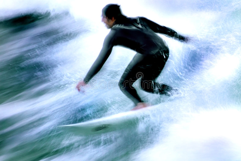 Surfer In Motion 4. Long exposure showing the speed and intensity of the surf and the surfer. Photo taken along the central coast of California royalty free stock photography