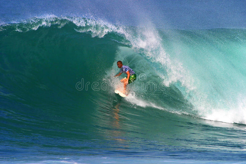 Surfer Pat O'connell Surfing in Hawaii. Photo of pro surfer, Pat O'connell, rides the tube of a wave during the Pipeline Masters surf contest, the third jewel of stock image