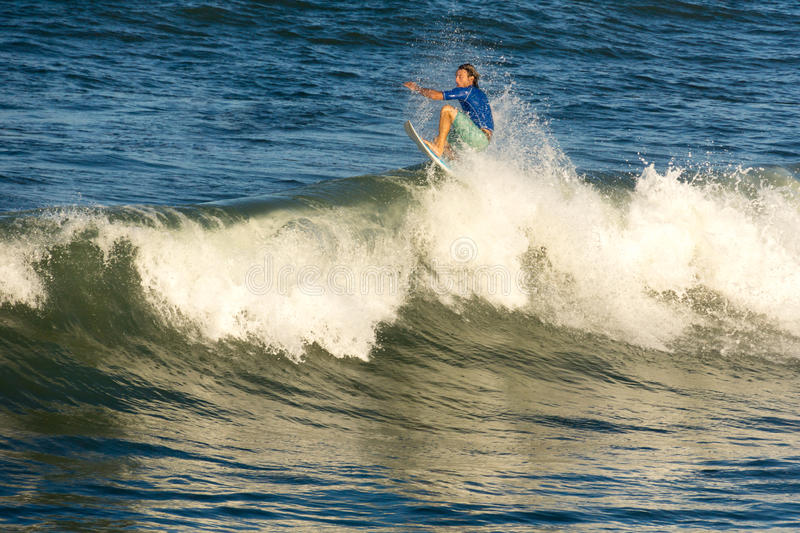 A surfer rides a tube II. Flagler Beach, Florida - September 21: A surfer rides a tube II on September 21, 2014. The beach is popular among surfers stock photography