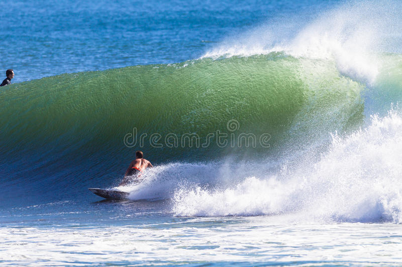 Surfer Rides Wave Editorial Photography
