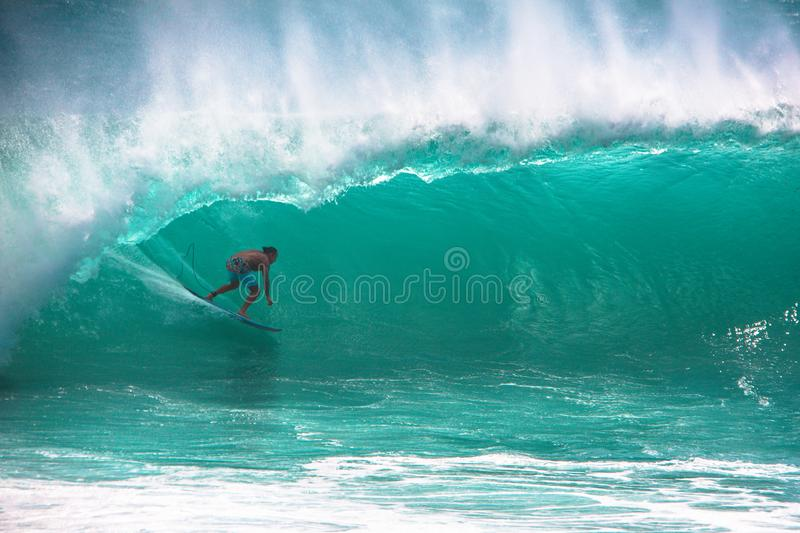 Surfer riding big wave in Bali stock photography