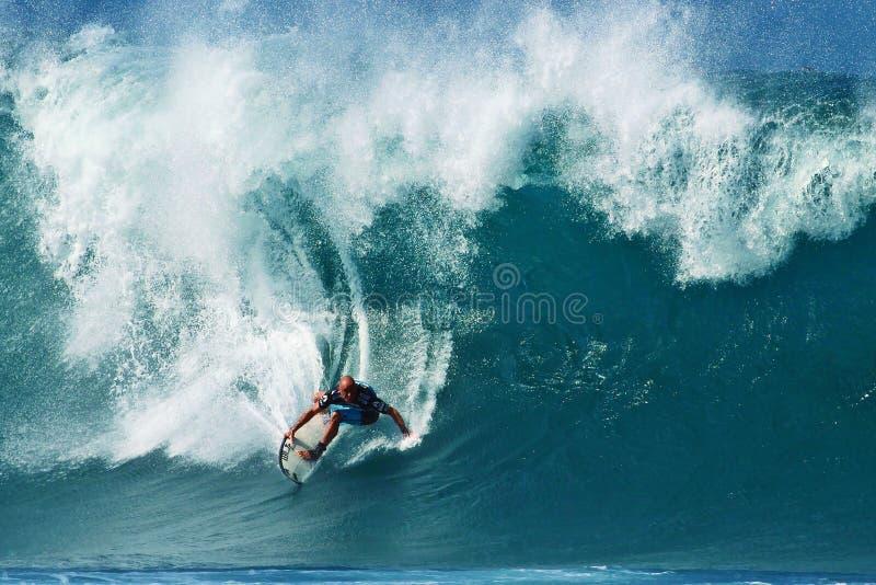 Surfer Shane Dorian Surfing Pipeline in Hawaii stock photo