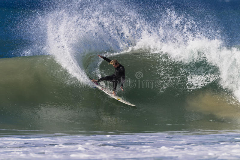 Surfer Wave Skill Power Carve stock photo
