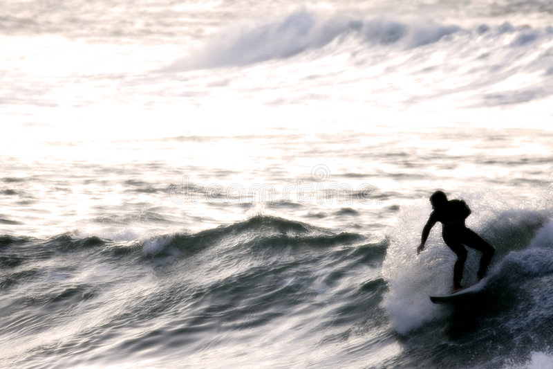 Surfer at Sunset royalty free stock photography