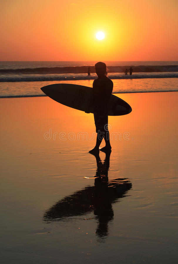Surfer on sunset royalty free stock photos