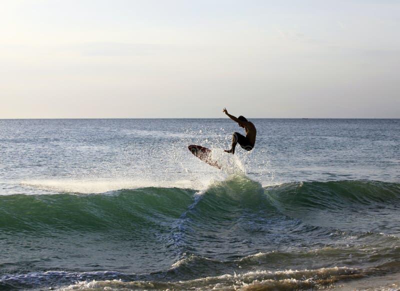 Surfer on sunset stock photos