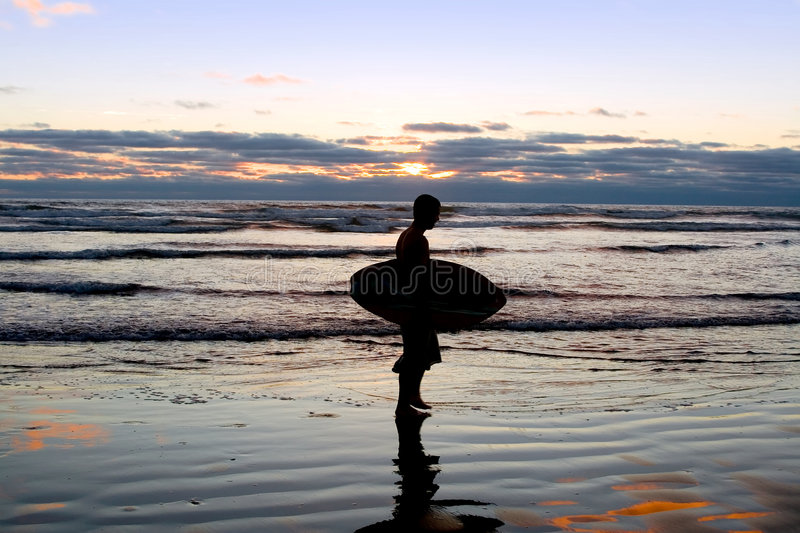 Download Surfer At Sunset On The Beach Stock Photo - Image: 2864780