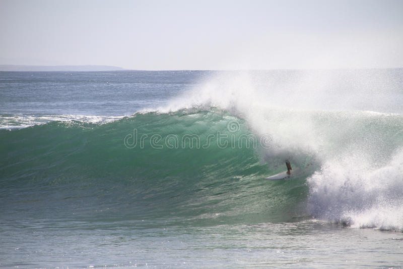 Surfer tube riding. A wave in Supertubos, Peniche, Portugal stock image