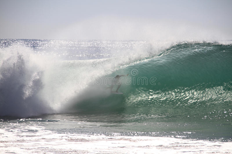 Surfer tube riding. A wave in Supertubos, Peniche, Portugal stock photo