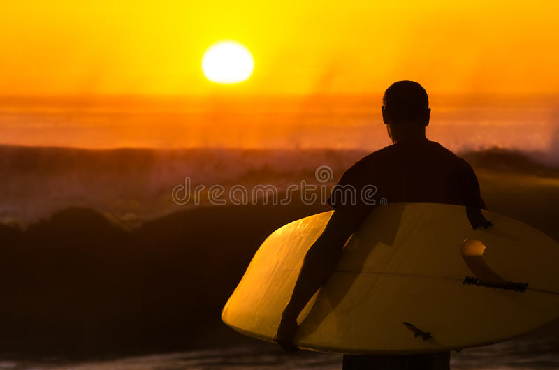 Surfer watching the waves royalty free stock photography
