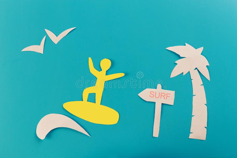 Surfer on wave. blue background. Paper cut royalty free stock image
