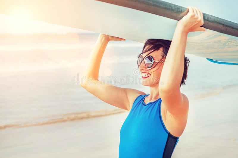 Surfer woman with longboard stock photo