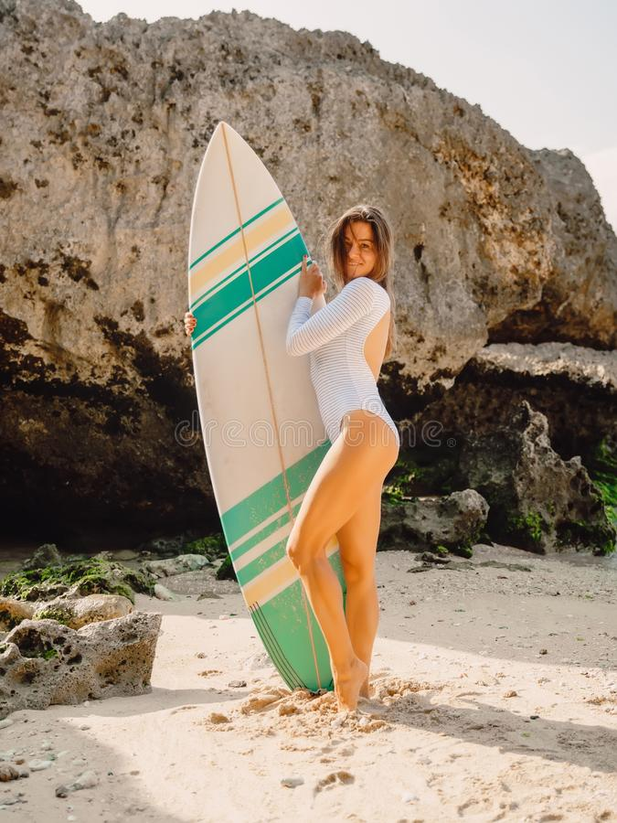 Surfer woman with surfboard. Surfing in ocean. Surfer woman with surfboard. Surfing in sea stock photo