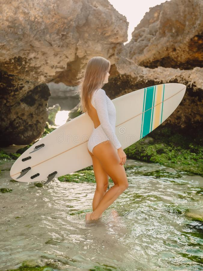 Surfer woman with surfboard. Surfing in ocean. Surfer woman with surfboard. Surfing in sea stock photography