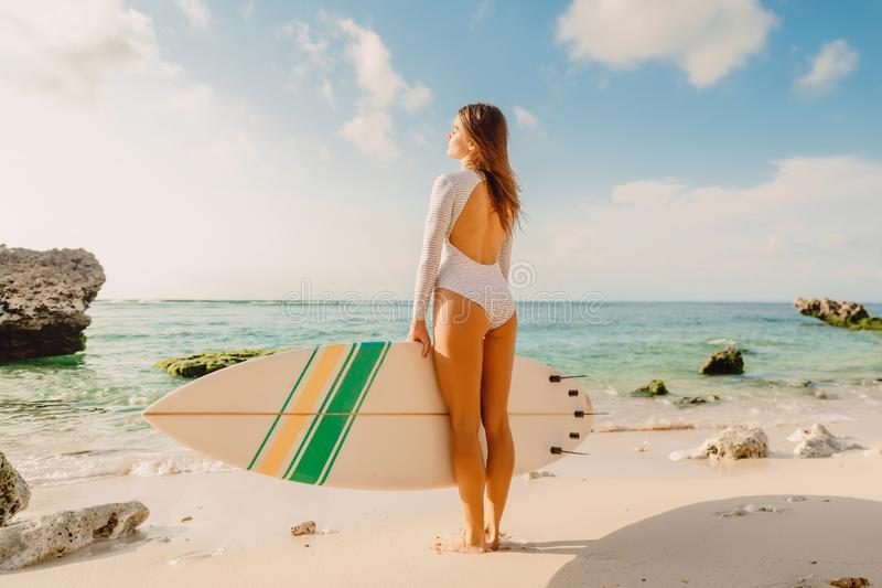 Surfer woman with surfboard. Surfing in ocean. Surfer woman with surfboard. Surfing in sea stock photos