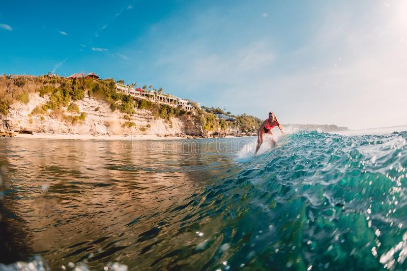 Surfer woman at surfboard on wave. Surfing in ocean. Surfer woman at surfboard on wave. Surfing in blue ocean stock photography