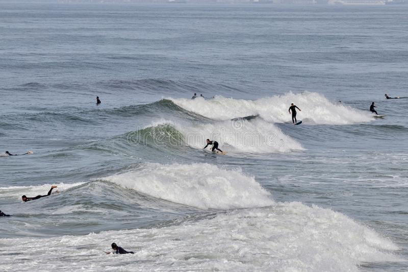 Surfers catching waves royalty free stock photo