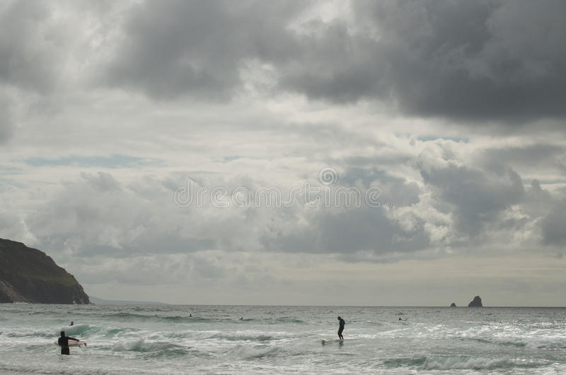 Download Surfers on a cloudy day stock image. Image of sunset - 83713717