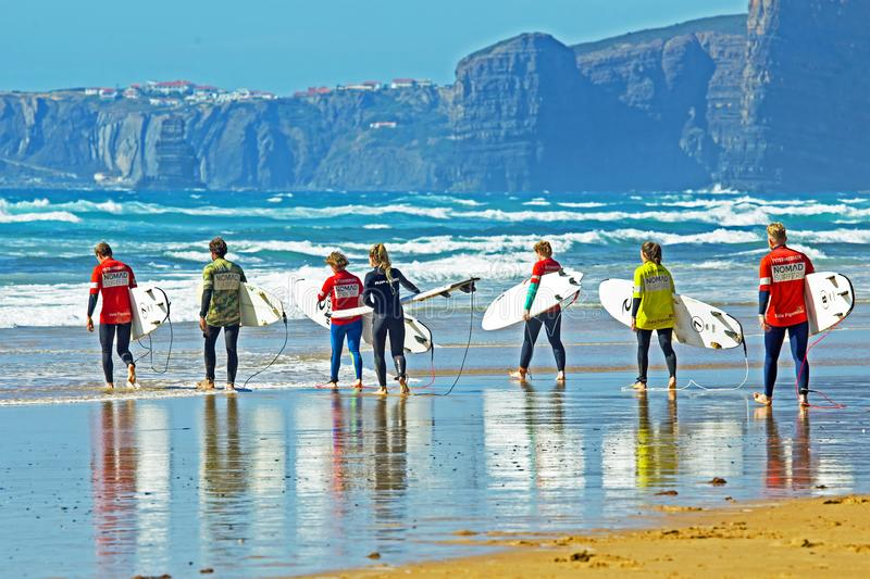 Surfers getting surfing lessons at Praia Vale Figueiras in Portugal. Vale Figueiras, Portugal - June 10, 2019:Surfers getting surfing lessons at Praia Vale royalty free stock photos
