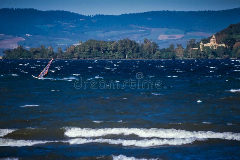 Bolsena, Lazio - Italy. Surfers on the lake of Bolsena Italy - The medieval town with castle on Lake Bolsena, region Latium, central Italy stock images