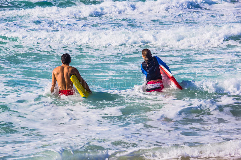 The surfers on municipal beach in Dubai stock images
