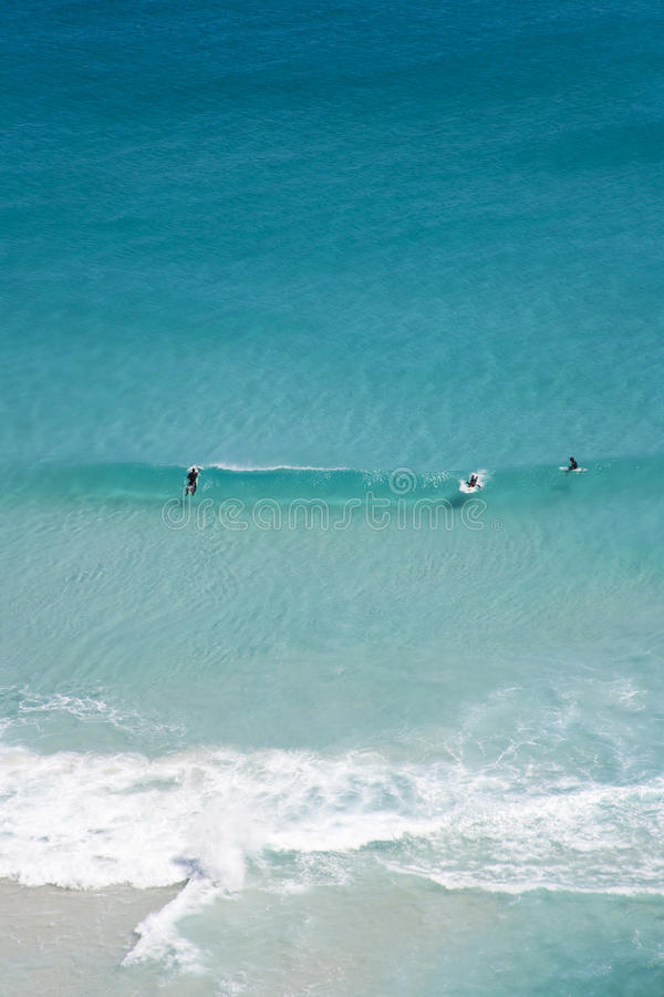 Surfers, Noordhoek Beach, Cape Town royalty free stock image