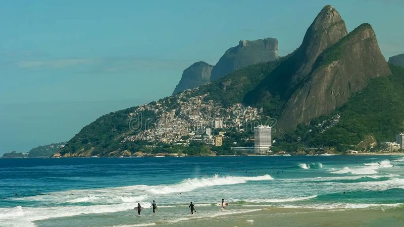 Surfers paddling out at ipanema beach in rio de janeiro royalty free stock photography