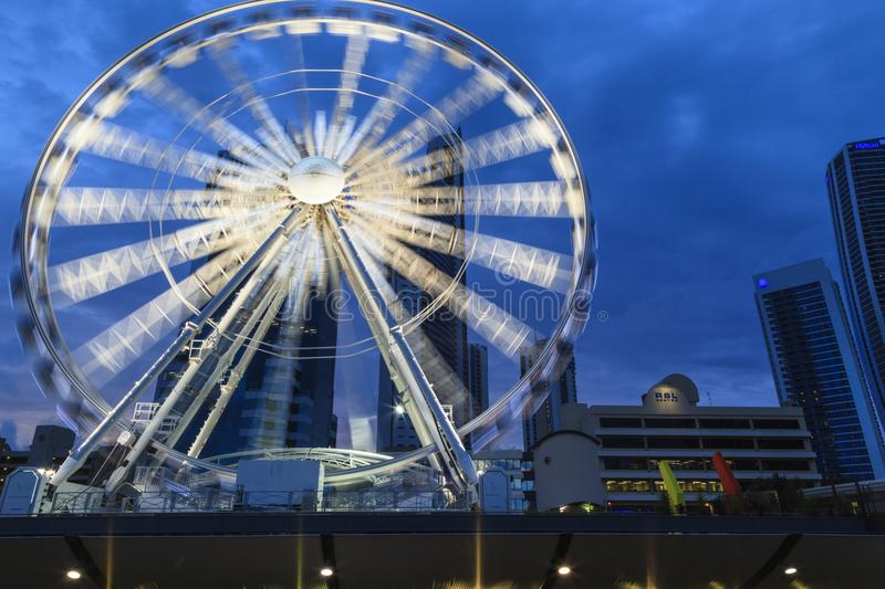 The Wheel of Surfers Paradise. SURFERS PARADISE - FEB 22: The Wheel of Surfers Paradise is a 60 meter tall Ferris wheel located on top of the Transit Centre. Feb royalty free stock image