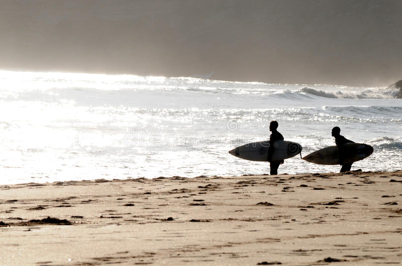 Surfers in Portugal royalty free stock photo