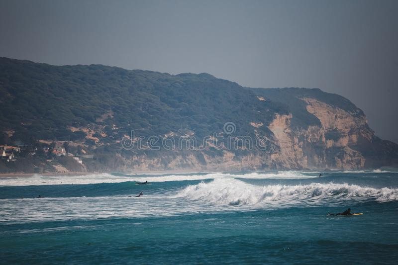Surfers on the sea with waves stock photos