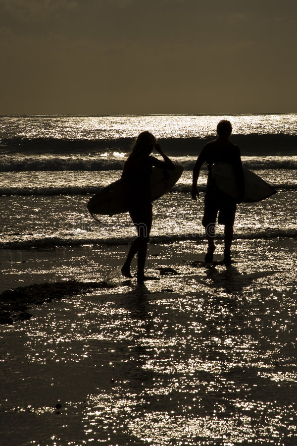 Free Surfers Sunset Stock Photography - 6232142