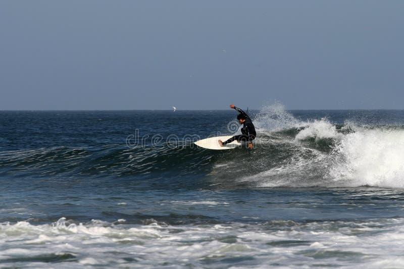 Surfing in Abreojos, Baja, Mexico stock photo