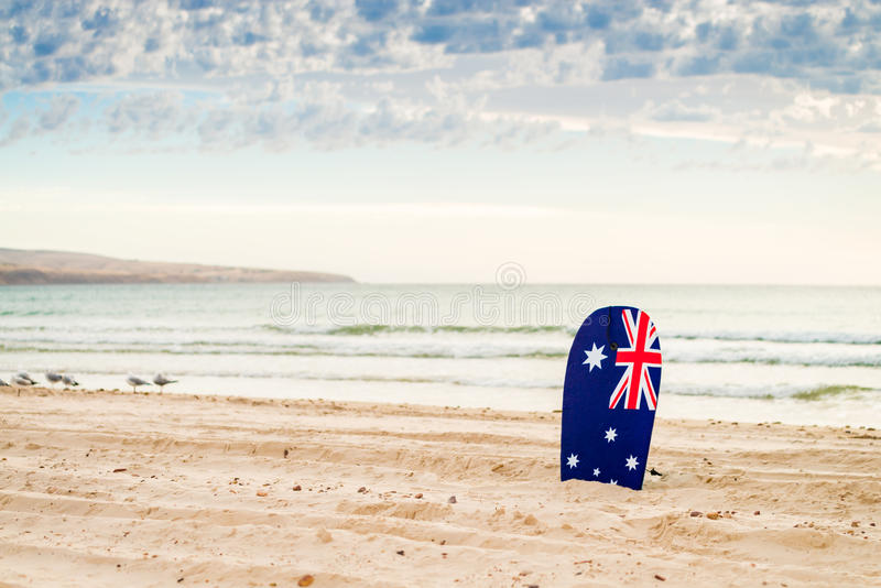 Surfing board with Australian flag. At the beach royalty free stock photography