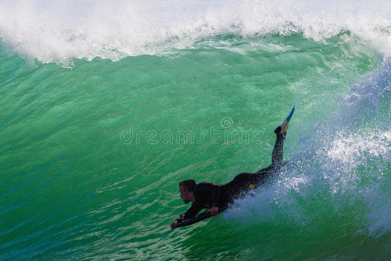 Body-Boarder Rides Wave royalty free stock photo