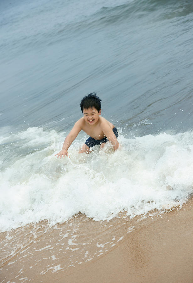 Surfing boy royalty free stock photos