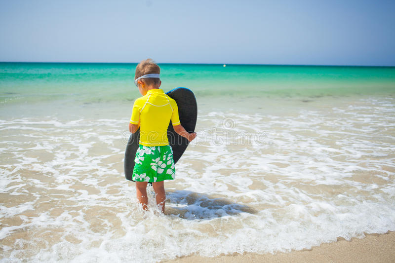 Surfing boy royalty free stock photos