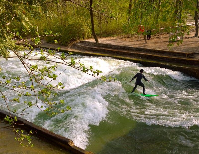 Surfing at Englischer Garden in Munich stock photo